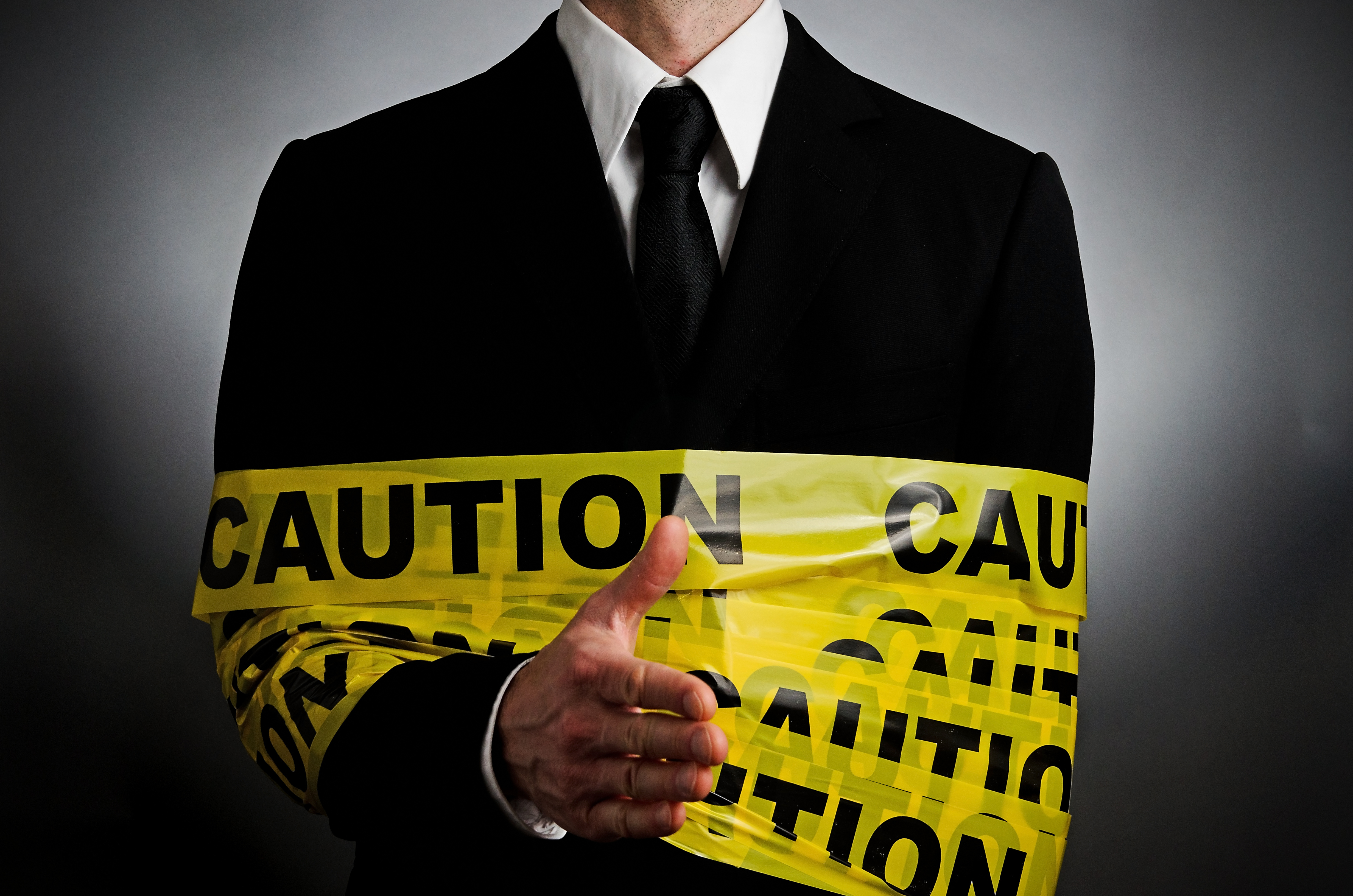Employee wrapped in caution tape representing an internal threat. Demonstrating the need for the Zero Trust model to protect against internal threats.
